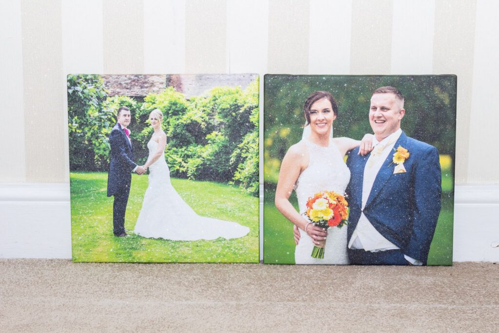 Two canvasses with glitter on showing a happy couple of their wedding day.