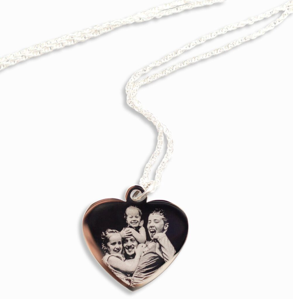 A product photo of an engraved necklace with a family on it